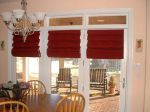We used hobble roman shades on these doors, they look as nice down as they do in the up position.