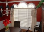 This is just enough to soften this dining room window over the wood blinds.  We covered the pole with the matching fabric and then used mahagony rings for contrast, it looks great with the walls.