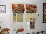 Another fun way to treat doors, you can operate these for privacy or sun. Notice the fun beading on the bottom!